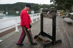 "That's Laurie stepping up to ""the stocks"". The text on the timber says: ""Only for people with short legs"""