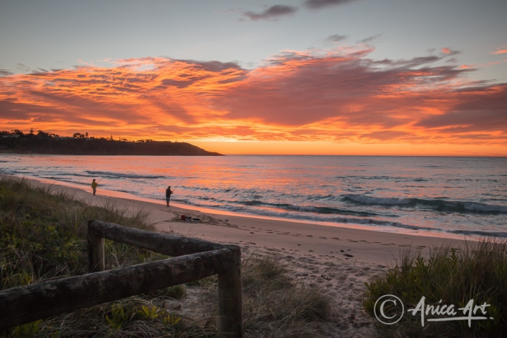 Two fishermen on Mollymook Beach at sunrise