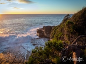 Sunrise off Bannisters Point in Mollymook with waves breaking on rocks