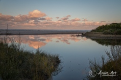 Sunset cloud reflections at Blackwater Creek in Mollymook