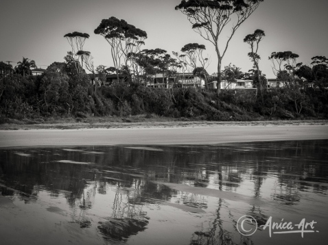 Low tide reflections at Narrawallee Beach in monochrome
