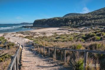 Down sandy steps to Pretty Beach