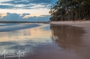Reflections on wet sand at southern end of Mollymook Beach